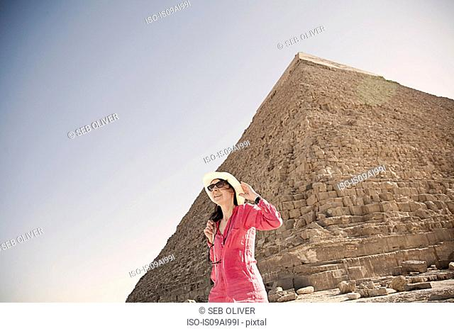 Mature woman tourist at The Great Pyramid of Giza, Egypt