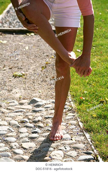 knee shot - legs of a woman walking barefoot on a pathway - trail - multiple-item operation sequence- alley - narrow path - station boulder boulders - stone...