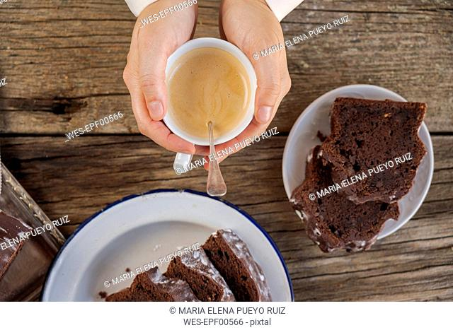 Homemade chocolate cake and cup of coffee on wood