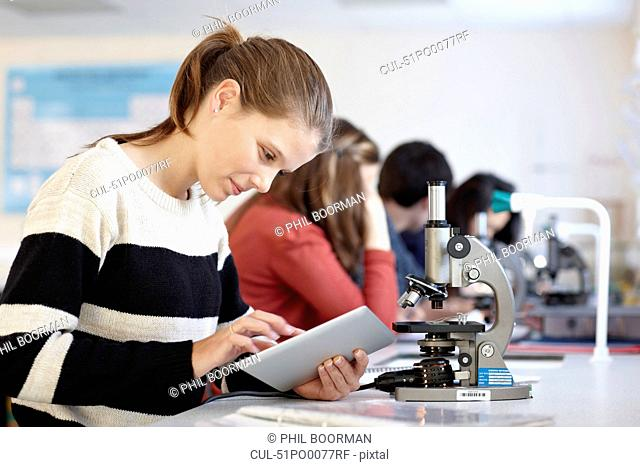 Student using tablet computer in class