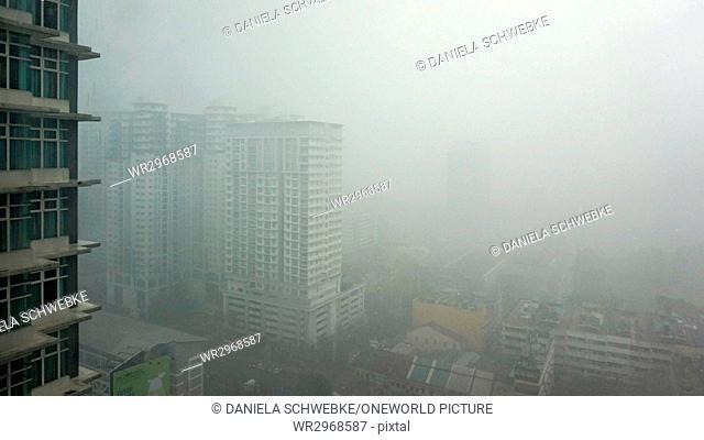 Malaysia, Wilaya Kuala Lumpur, Kuala Lumpur, foggy view from the Ramada Hotel Kuala Lumpur