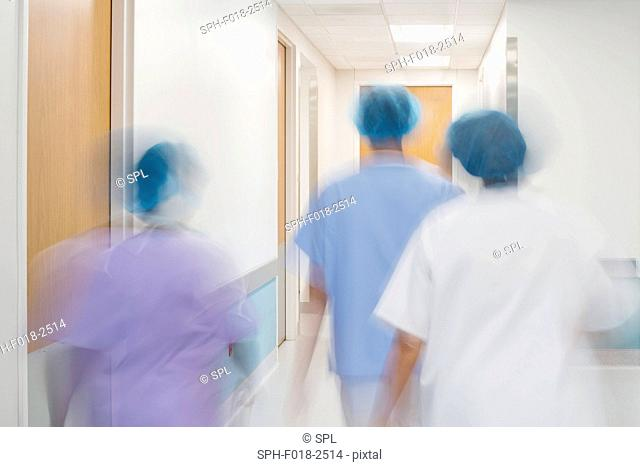 Medical staff walking down hospital corridor