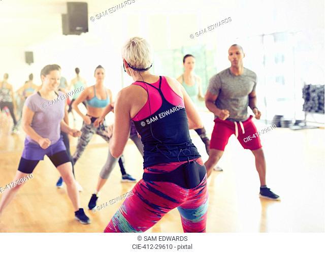 Fitness instructor leading aerobics class