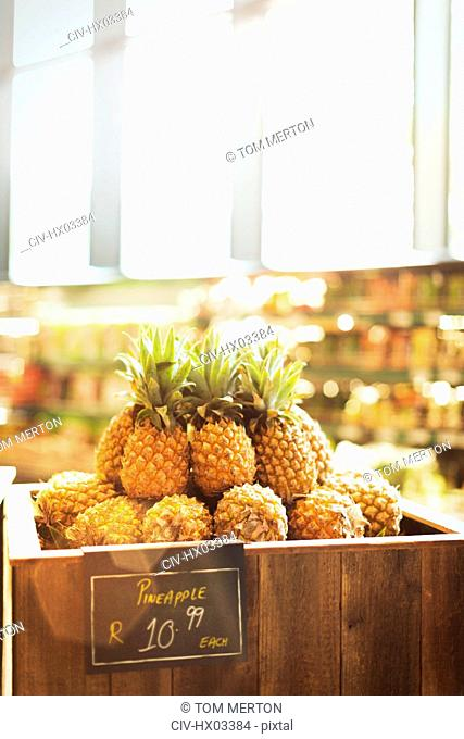 Pineapples on display in grocery store market