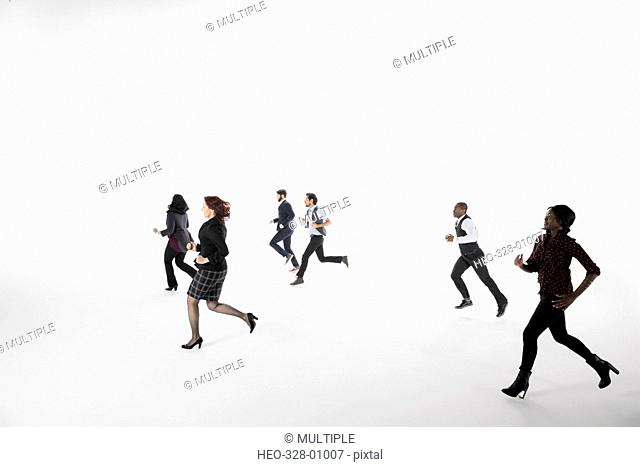 Business people running against white background