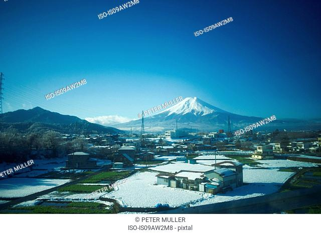 Elevated view of winter landscape and snow capped Mount Fuji, Tokyo, Japan