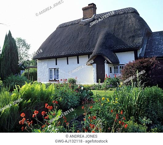 ENGLISH TRADITIONAL THATCHED COUNTRY COTTAGE WITH SUMMER PERENNIAL GARDEN
