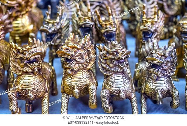 Chinese Replica Bronze Dragons Panjuan Flea Market Decorations Beijing China. Panjuan Flea Curio market has many fakes, replicas and copies of older Chinese...