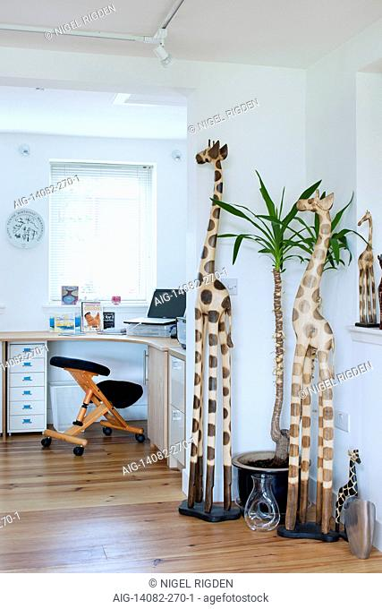 Looking from the main living space into the office with giraffe statues in UK home