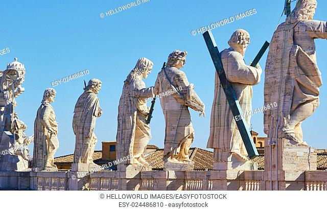 Statues of Jesus and the Apostles lining rooftop facade of St Peter's Basilica, Vatican City, Rome, Lazio, Italy, Europe