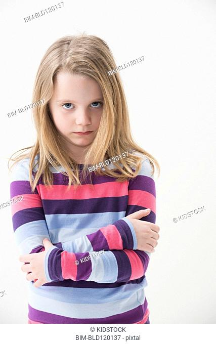 Girl pouting with arms crossed