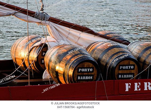 Port Wine Barrels on wine barge At sunset  Porto, Portugal