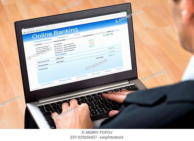 Close-up Of Businessperson Doing Online Banking On Laptop