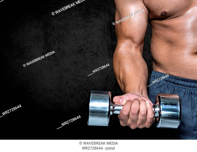 Man performing dumbbell curl exercise against black background