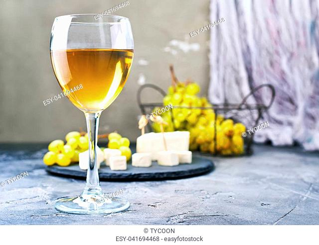 white wine and cheese on a table