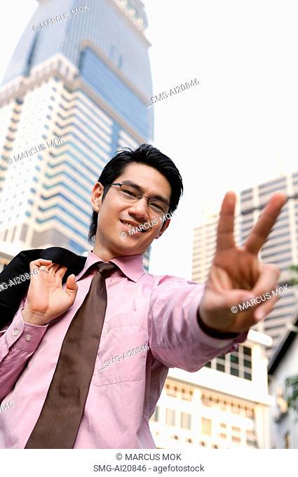 Businessman making hand sign