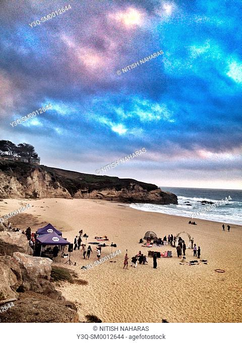 Party on a beach in Moss Beach, California, USA