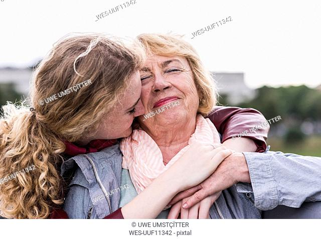 Portrait of happy grandmother with her granddaughter