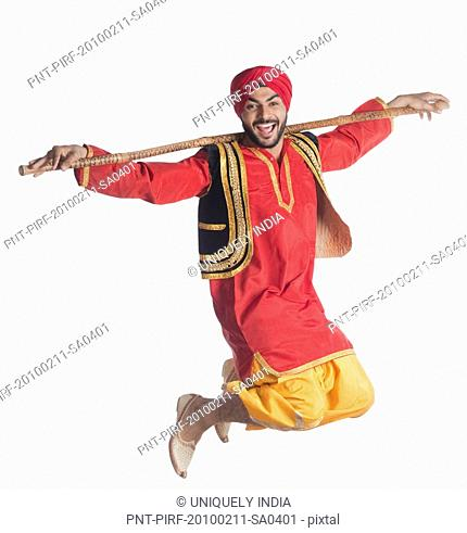 Man doing Bhangra the folk dance of Punjab in India
