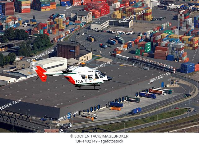 BK 117 police helicopter of the North Rhine-Westphalian police flying squadron during a mission flight, Ruhrort port, Duisburg, North Rhine-Westphalia, Germany
