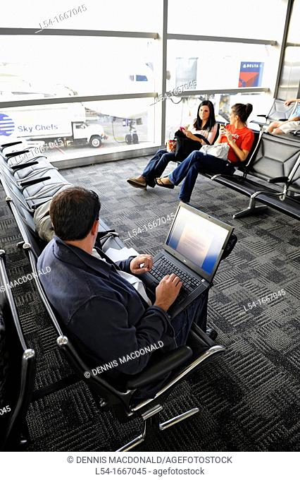 Passengers Using Technology Detroit Metro Airport Terminal Michigan Traveler