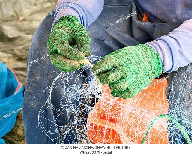 Thailand, Chang Wat Phang-nga, Tambon Khuekkhak, Fishing net in the hands of a fisherman