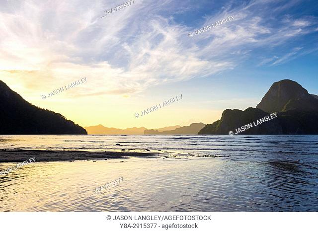 Bacuit Bay and Cadlao Island at sunset seen from Caalan Beach, El Nido, Palawan, Philippines