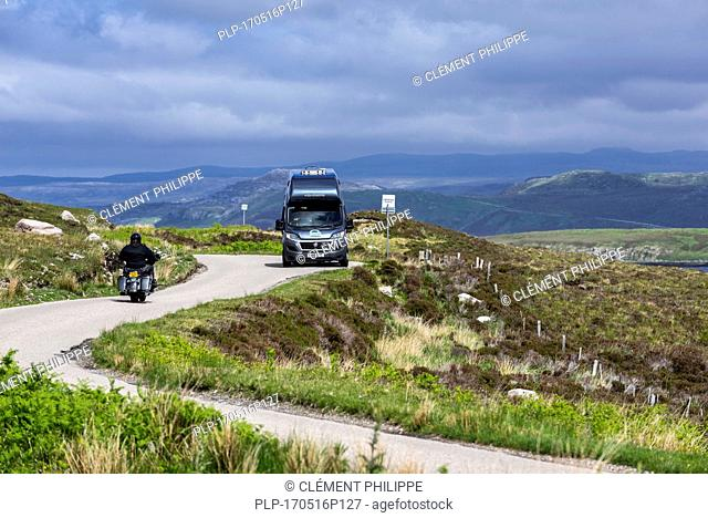 Motorhome and motorbike at passing place on winding single track road in the Scottish Highlands, Scotland, UK