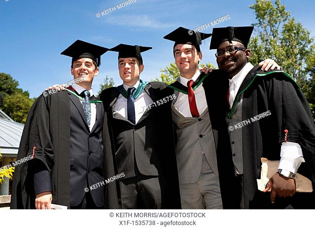 Four male Aberystwyth university students graduating on graduation day, UK