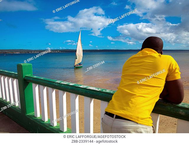 Man Looking At A Dhow In The Bay, Inhambane, Mozambique