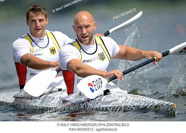 Ronald Rauhe and Tom Liebscher (L) cheer after their victory for the European Championship title in the canoe double over 200 meters during the European...