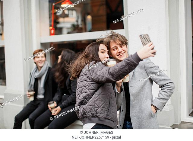 Teenagers taking selfie