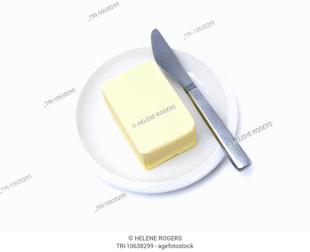 Block Of Butter On A Plate With A Knife By The Side