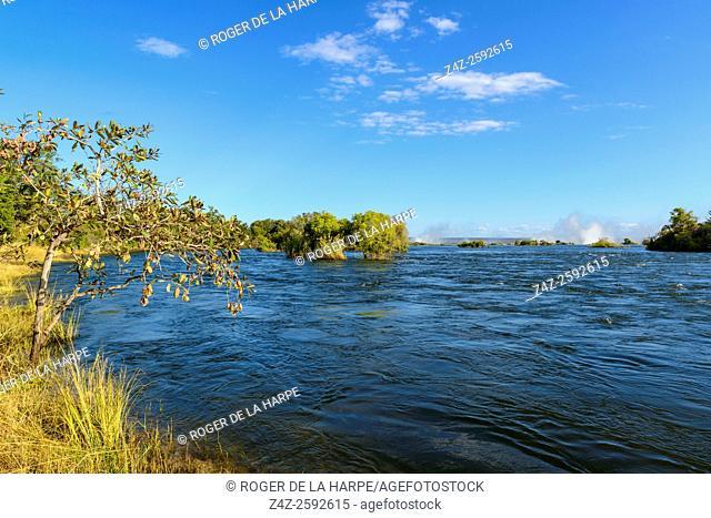 Zambezi River view with the spray from . Victoria Falls in the distance. Livingstone. Zambia