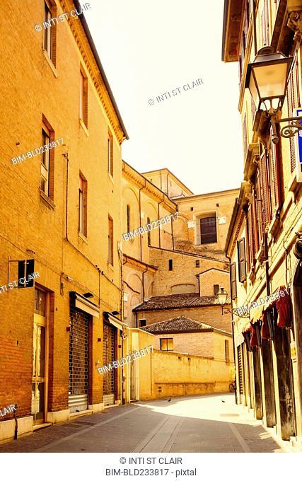Empty street between buildings, Bologna, Emilia-Romagna, Italy