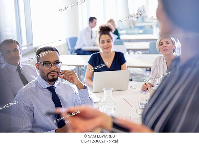 Business people listening in conference room meeting