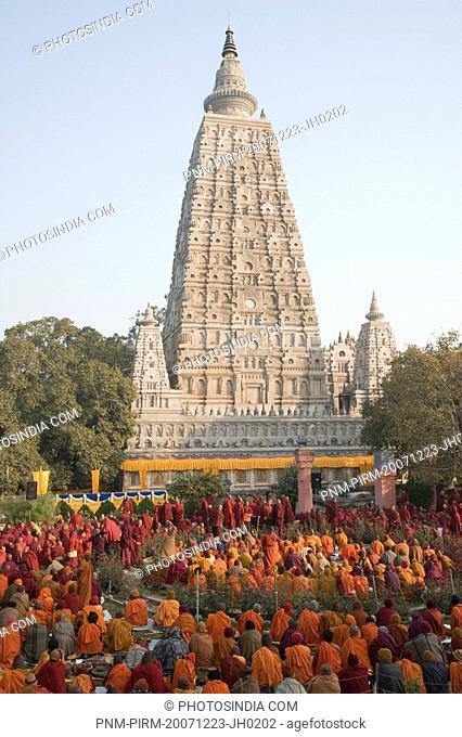 Monks praying in front of a temple, Mahabodhi Temple, Bodhgaya, Gaya, Bihar, India