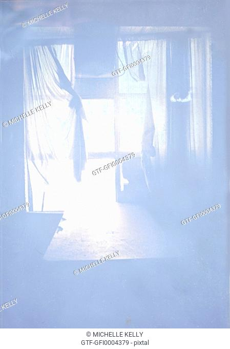 faded image of sun shining through curtains on old window