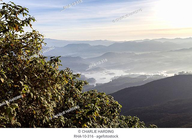 Looking down into the Dalhousie and the Hill Country beyond at sunrise from Adam's Peak (Sri Pada), Sri Lanka, Asia
