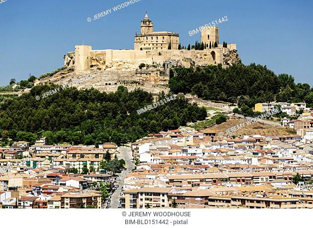 Low angle view of castle on hilltop over Alcala de Real, Andalusia, Spain