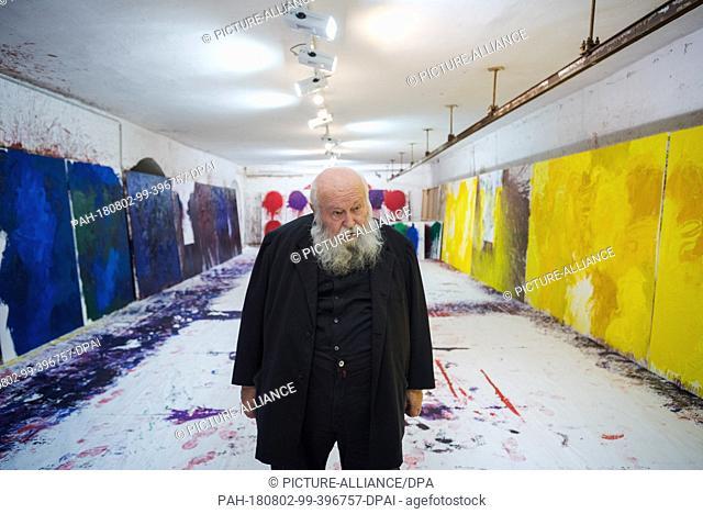 01 August 2018, Austria, Prinzendorf an der Zaya: The Austrian painter and action artist Hermann Nitsch stands between some of his works in the studio at...