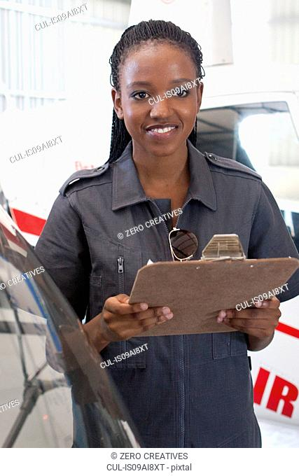 Student pilot holding clipboard