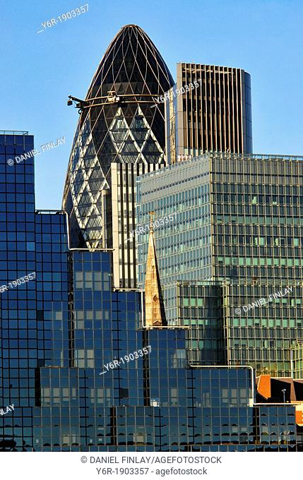 View of modern buildings in the City of London, England, financial district seen from across the River Thames