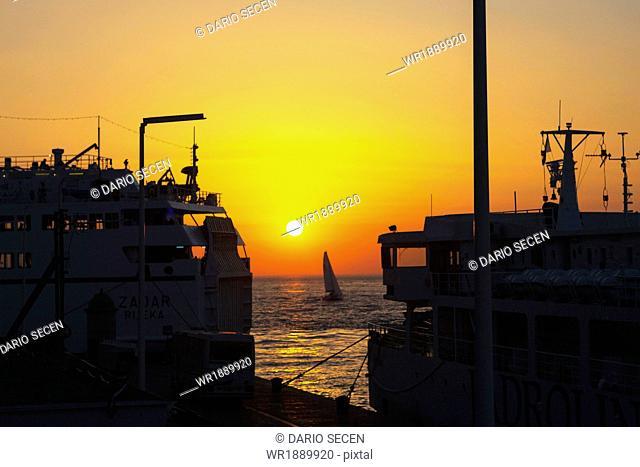 Harbor with ships at sunset, Zadar, Croatia