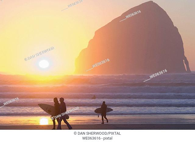 Silhouetted Surfers at Sunset - Pacific City, Oregon, USA