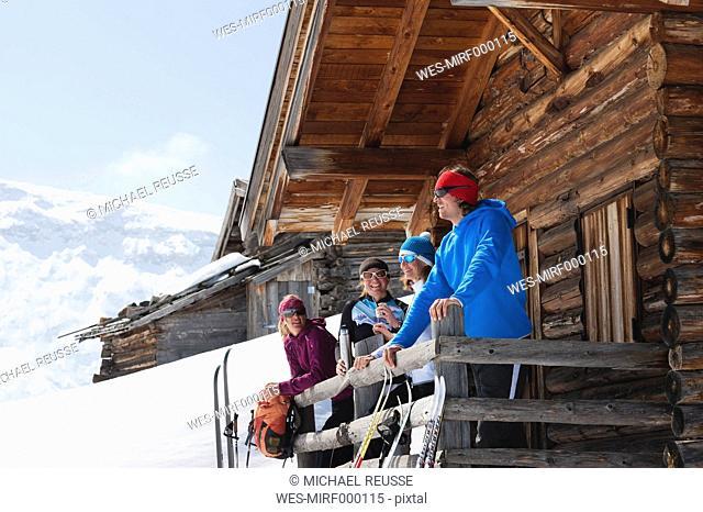 Italy, Trentino-Alto Adige, Alto Adige, Bolzano, Seiser Alm, People standing outside ski resort near railings