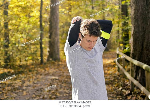 Young man sport stretching exercise fitness autumn