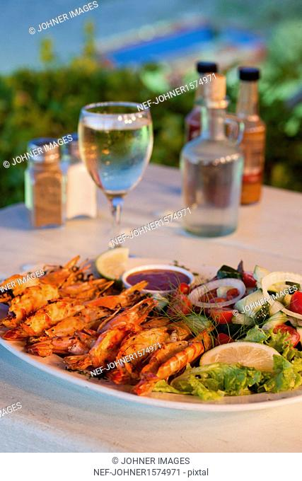 Grilled crayfish on plate