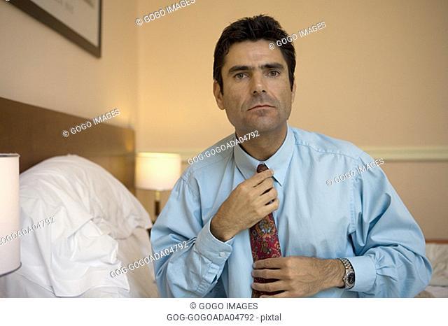 Businessman tying his tie