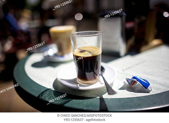Coffee sits on a table on a coffee shop's terrace in Prado del Rey village, Cadiz province, Andalusia, Spain